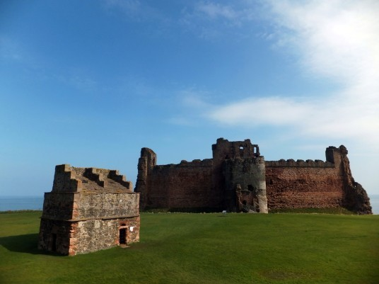 Tantallon Castle, a spectacular ruinous castle of the Douglas Earls of Angus, located in a pretty cliff top location near the East Lothian seaside town of North Berwick.Tantallon Castle: with doocot (© Martin Coventry)